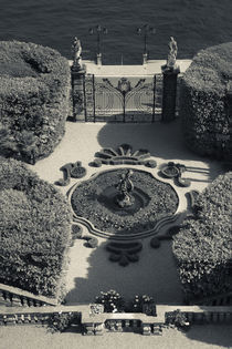 High angle view of a fountain in a garden by Panoramic Images