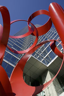 Low angle view of a sculpture in front of a building by Panoramic Images