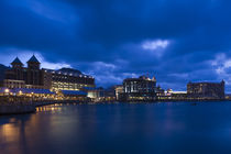 Buildings at the waterfront lit up at dusk von Panoramic Images