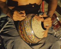 Mid section view of a person etching a pottery, Costa Rica by Panoramic Images