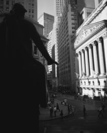 Silhouette of George Washington statue in front of a financial building by Panoramic Images