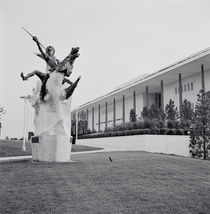 Statue in front of a building by Panoramic Images