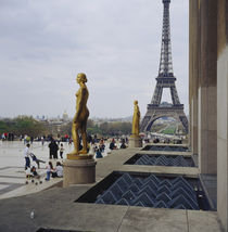 Gilded statue of a woman with a tower in the background von Panoramic Images