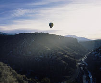 Silhouette of a hot air balloon in the sky, Taos County, New Mexico, USA by Panoramic Images