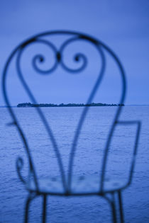 Small island viewed through a chair by Panoramic Images
