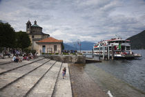 Ferry at a harbor, Cannobio, Lake Maggiore, Piedmont, Italy by Panoramic Images