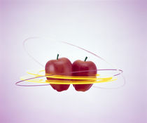 Two floating red apples surrounded by yellow rings by Panoramic Images