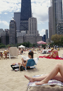 Group of people on the beach, Oak Street Beach, Chicago, Illinois, USA by Panoramic Images