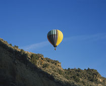 Low angle view of a hot air balloon in the sky, Taos County, New Mexico, USA by Panoramic Images