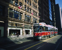 Cable car moving on a road, Toronto, Ontario, Canada by Panoramic Images