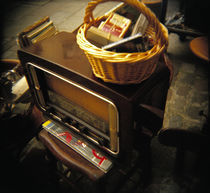 High angle view of a wicker basket on an antique radio set, France von Panoramic Images