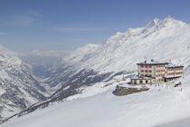 Hotel on a snowcovered landscape, Riffelberg Hotel, Zermatt, Switzerland by Panoramic Images