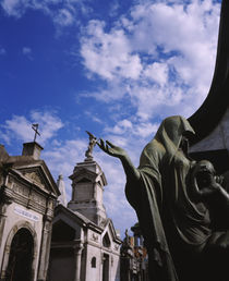 Low angle view of a statue in a cemetery von Panoramic Images