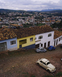 High angle view of cars parked in front of houses in a city by Panoramic Images
