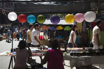 People shopping in a street market by Panoramic Images