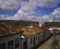 High angle view of houses along a cobblestone street by Panoramic Images