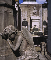 Close-up of an angel statue in a cemetery by Panoramic Images