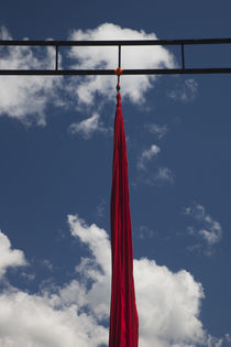 Red silk textile hanging for acrobatic performance by Panoramic Images