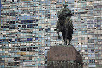 Statue of General Artigas with a building in the background by Panoramic Images