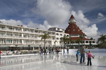 Tourists ice-skating in a hotel by Panoramic Images