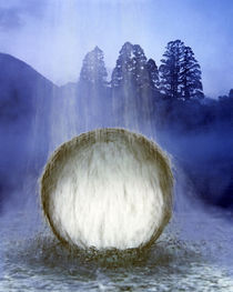 Water cascading over crystal sphere with silhouette of trees in background von Panoramic Images