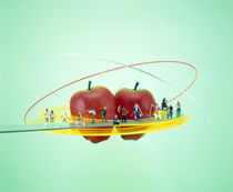 Small figures standing on circular yellow catwalk  by Panoramic Images