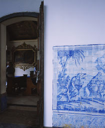 Decorative tile work on the wall of a church by Panoramic Images