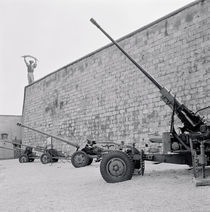 Cannons in front of a wall by Panoramic Images
