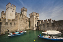 Boats in a lake near a castle by Panoramic Images