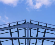 Low angle view of a steel framework for a warehouse under construction, USA by Panoramic Images