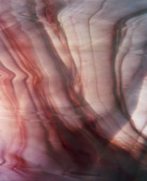 Close up of fabric with red and white marbling by Panoramic Images