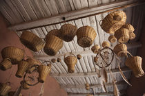 Wicker baskets and dreamcatchers hanging in a restaurant by Panoramic Images