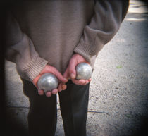 Mid section view of a man holding boules, Boule game, Paris, France by Panoramic Images