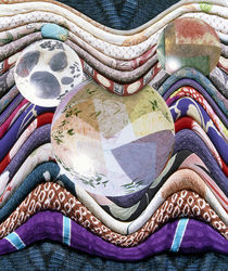 Three crystal balls lying on folded fabric by Panoramic Images