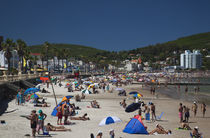 Tourists on the beach, Playa Piriapolis, Piriapolis, Maldonado, Uruguay by Panoramic Images