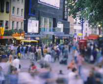 Crowd standing in front of a movie theater, Theater District, London, England von Panoramic Images