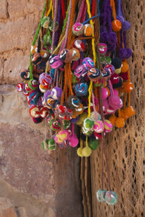 Multi-colored hangings on wall von Panoramic Images