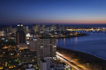 Buildings lit up at dusk, Punta Del Este, Maldonado, Uruguay by Panoramic Images