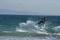 Kite surfer jumping over a wave, Playa de los Lances, Tarifa, Spain. by Sami Sarkis Photography