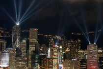Laser show over city at night, Hong Kong, China. by Sami Sarkis Photography