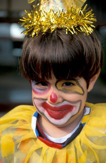 A boy with a clown costume on Purim holiday by Hanan Isachar