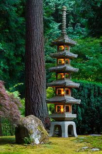 Pagoda lantern lit in Portland Japanese Garden by Chris Bidleman