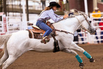 Ladies Barrel Racing at the rodeo by Joel Morin