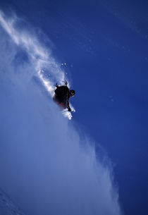 Skier turning off piste. by Ross Woodhall