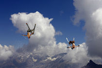 Two skiers backflipping by Ross Woodhall
