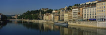 Buildings on the waterfront, Saone River, Lyon, France by Panoramic Images