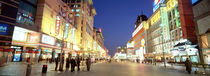 Shops lit up at dusk, Wangfujing, Beijing, China von Panoramic Images