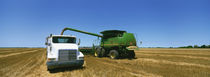 Combine in a wheat field, Kearney County, Nebraska, USA von Panoramic Images