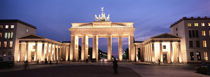 Low angle view of a gate lit up at night, Brandenburg Gate, Berlin, Germany von Panoramic Images