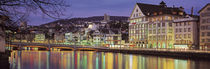 Switzerland, Zurich, River Limmat, view of buildings along a river by Panoramic Images